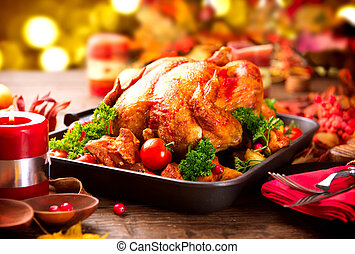 Thanksgiving dinner table served with turkey, decorated with...