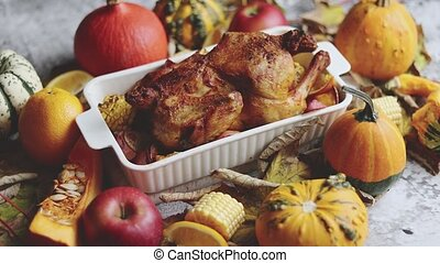 Thanksgiving dinner table with roasted whole chicken or ...