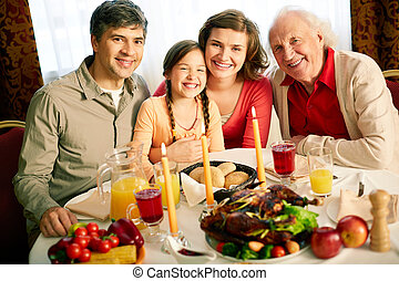 Thanksgiving evening - Portrait of happy family looking at ...