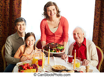 Thanksgiving evening - Portrait of happy family looking at...