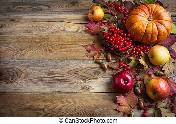 Thanksgiving greeting background with orange pumpkins, apples and fall leaves