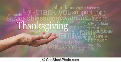 Female hand outstretched with palm side up and a white 'Thanksgiving' word floating above on a multicolored background