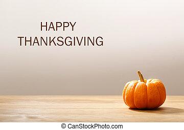 Thanksgiving message with orange pumpkin
