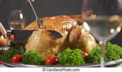 Thanksgiving or Christmas turkey dinner. Carving the turkey ...