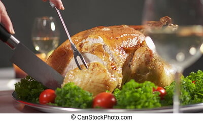 Carving the turkey in slow motion cutting juicy breast meat....