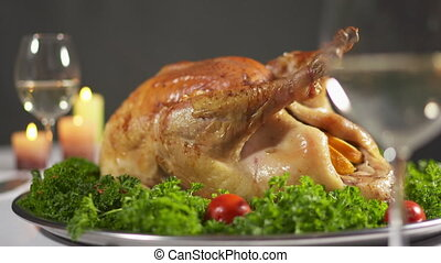 Thanksgiving or Christmas turkey dinner. Roasted turkey steaming on tray