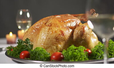 Thanksgiving or Christmas turkey dinner. Whole roasted turkey steaming on tray