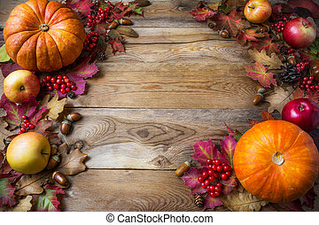 Thanksgiving or fall concept with pumpkins and apples, copy space