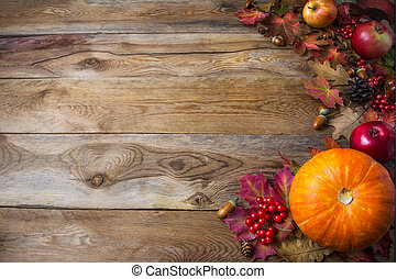 Thanksgiving or fall greeting background with pumpkins and fall leaves