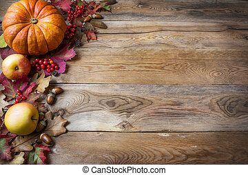 Thanksgiving or fall greeting with pumpkins, berries and fall leaves