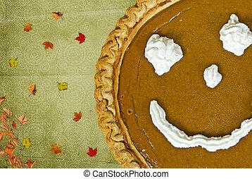 Thanksgiving Pie - Happy face on a pumpkin pie.