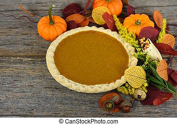 Thanksgiving pumpkin pie - pumpkin pie with autumn leaves...