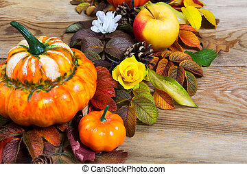 Thanksgiving rustic decoration with pumpkins and silk flowers
