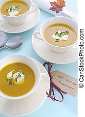 Thanksgiving table setting with pumpkin soup. - Happy...