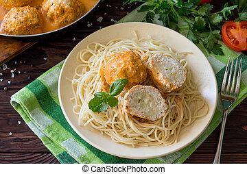 Thanksgiving Turkey dinner. Meat balls turkey with cauliflower in tomato sauce on a wooden table.
