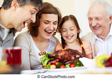 Thanksgiving turkey - Portrait of happy family sitting at...