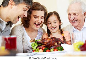 Thanksgiving turkey - Portrait of happy family sitting at ...