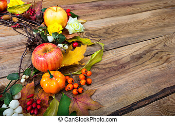 Thanksgiving wreath with pumpkin, apples, barberry, rowan, copy space