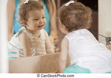 That is me on the mirror! - Cute baby girl looking at...