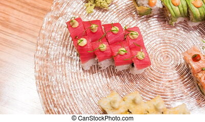 Horizontal dolly shot of different delicious rolls