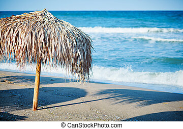 Thatch umbrella on beach