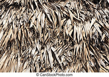 close up details of a thatched roof background