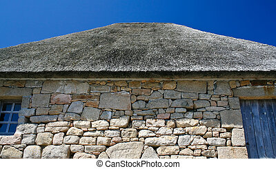 thatched roof of old Breton house on Ile de Brehat, Brittany...
