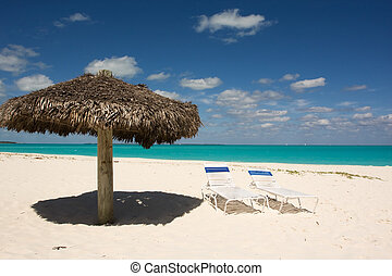 thatched sunshade on a tropical beach in the Bahamas