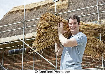 Thatcher Carrying Bundles Of Reeds Working On Roof