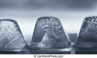 Thawing ice cube close-up timelapse