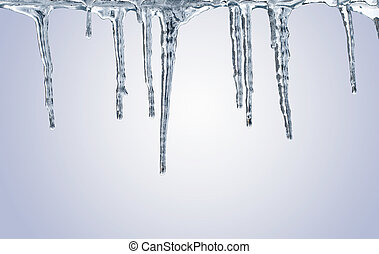 Thawing icicles isolated on blue