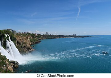 The 40m High Duden Waterfall and Small Boat in the Ocean -...