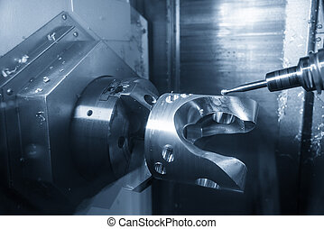 The 5-axis CNC machining center cutting the automotive part with solid ball end mill. The hi technology manufacturing process of automotive parts.