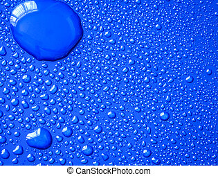 The Abstract water drop on surface of  fresh blue background
