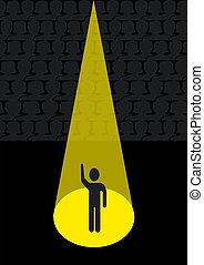 The actor in the rays of the searchlight on the stage of the theater.