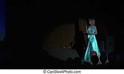 The actress on the stage in a beam of light
