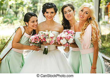 The adorable bride with bridesmaids