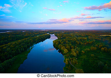 The Aerial view of river in sunset.