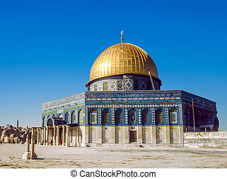 The afternoon sun shines on the golden Dome of the al Aqsa...