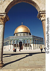 The afternoon sun shines on the golden Dome of the Rock and church steeples on the skyline of the Old City of Jerusalem