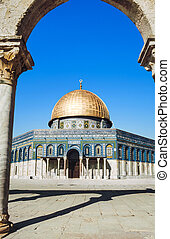 The afternoon sun shines on the golden Dome of the Rock