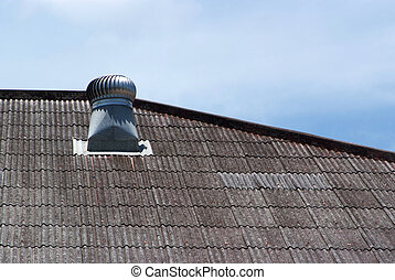 The air vent on the roof of the factory.