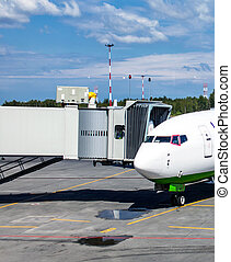 The airplane and ramp for boarding passengers