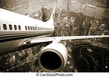 the airplane take off from the city night.