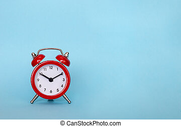 The alarm clock on a color background with free space for text