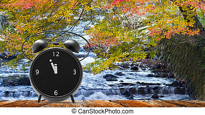 alarm clock with little minutes to twelve o'clock - The ...