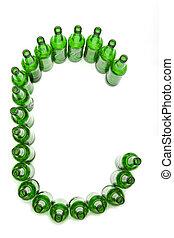 The alphabet from glass beer bottles. Letter C