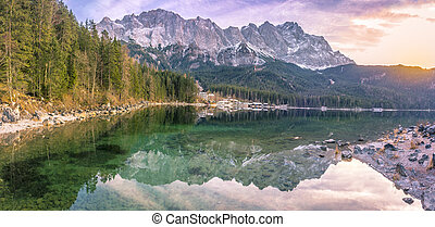 The Alps reflected in water at sunset