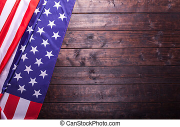 The American Flag Laying on a Wooden Background - The...