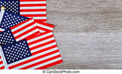 The American Flag Laying on a Wooden Background - US...